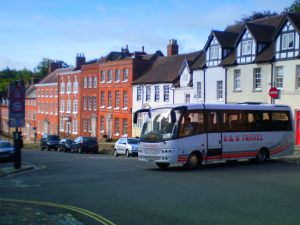 Historic buses plying historic Ludlow