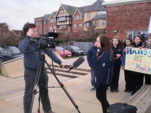 Youth protester Laura Sheldon interviewed by ITV's Gareth Edwards